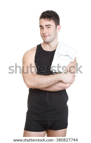 Healthy young man in sportswear with towel isolated on white background