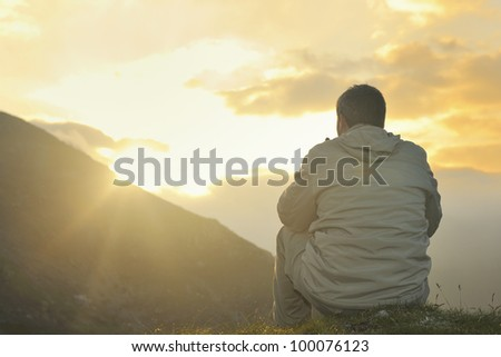 healthy young man practice yoga in height mountain at early morning and sunrise