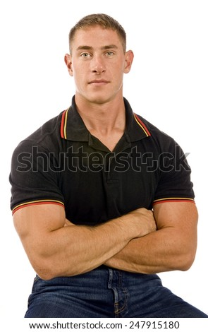 Healthy Young Man Sitting With Arms Crossed/ Handsome Young Man With Arms Crossed - stock photo