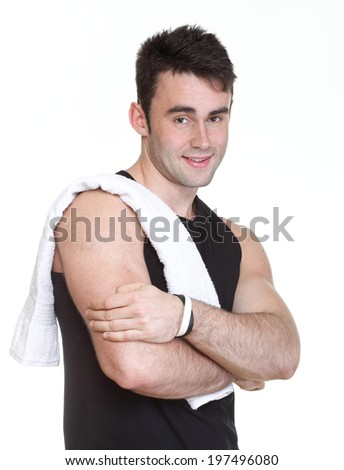 Healthy young sporty man with towel isolated on white background - stock photo