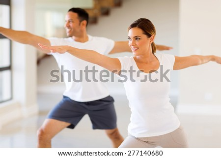 healthy young woman and man workout at home - stock photo