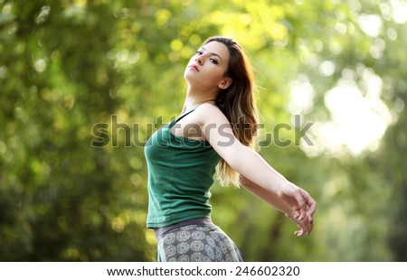 Healthy young woman in nature - stock photo