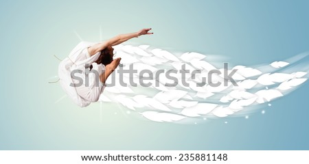 Healthy young woman jumping with feathers around her concept on bright background - stock photo