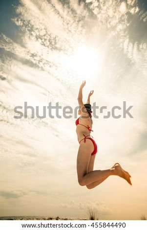 healthy young woman laughing with beach ball while on the beach in summer. vacation, sport and people concept - young woman with ball playing volleyball - stock photo