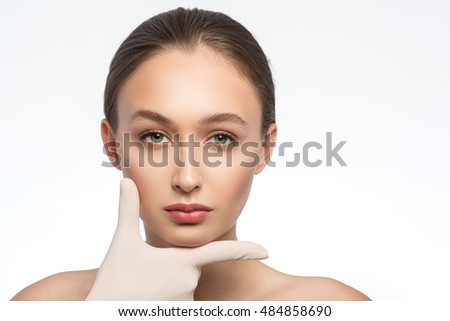 Healthy young woman satisfied of facial treatment