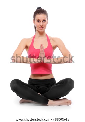 Healthy young woman sitting in lotus pose on a white background.
