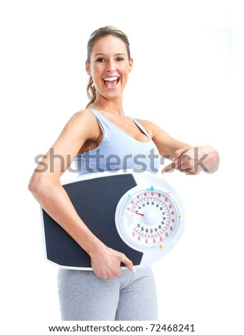 Healthy young woman with a weight scale. Isolated over white background - stock photo