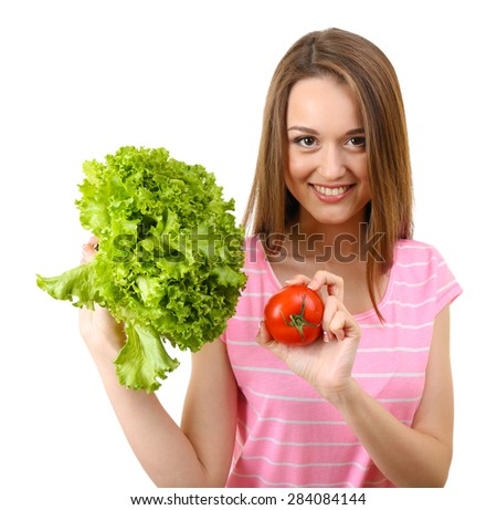 Healthy young woman with bunch of lettuce and tomato isolated on white