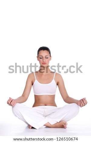healthy young woman  with closed eyes meditating  over white background - stock photo
