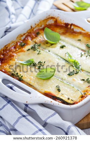 Healthy zucchini lasagna bolognese in a baking dish - stock photo