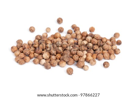 Heap Coriander Seeds (Coriandrum sativum) isolated on white background. Also called Cilantro or Dhania or Malli. Used in cooking and to give a pleasant scent in perfumery, cosmetics, soap-making.