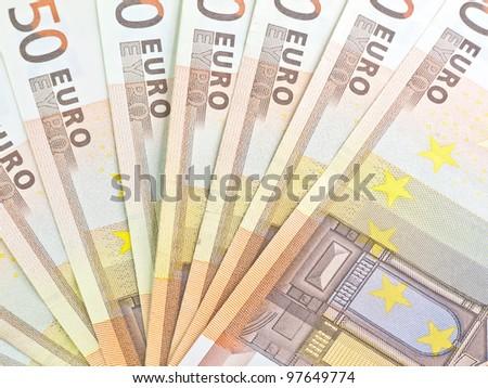 Heap from euro denominations on 50 euros - stock photo