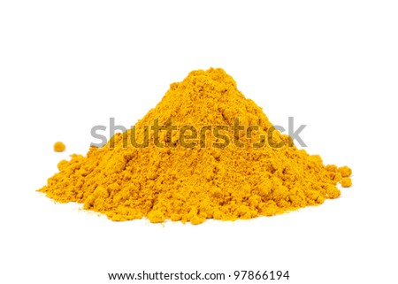 Heap ground Curry (Madras Curry) isolated on white background. Used as a spice in cuisines all over the world.
