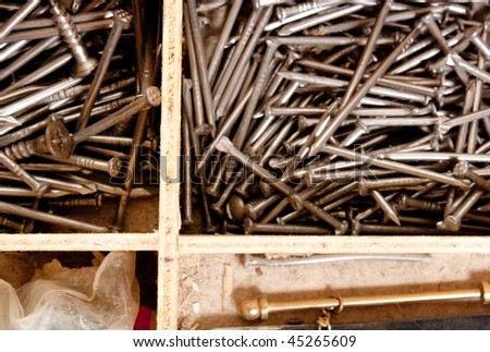 heap nails in wooden toolbox