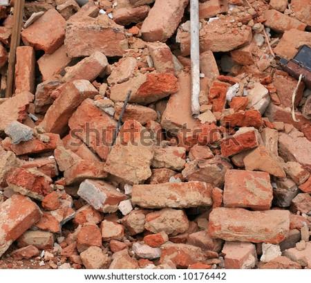 Heap of a beaten brick - grunge background - stock photo