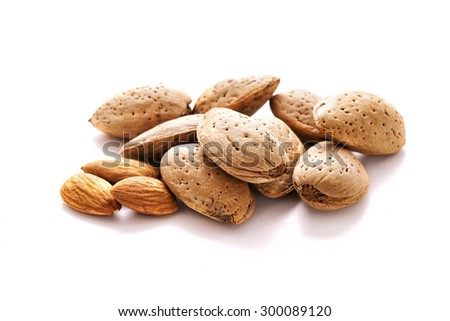 heap of almonds in the shell over white background - stock photo