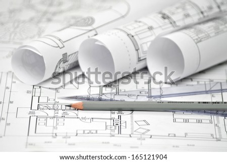 heap of architectural design and project blueprints drawings of house. technical drawings. - stock photo
