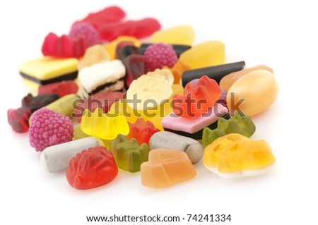 Heap of assorted colorful candy isolated on white background. - stock photo