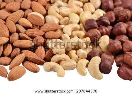 Heap of assorted nuts on a white background - stock photo