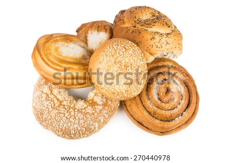 Heap of baking some delicious sweet rolls isolated on white background - stock photo