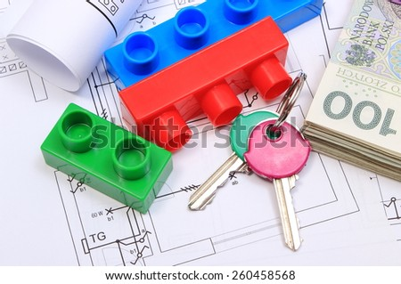 Heap of banknotes, home keys, plastic building blocks and electrical diagrams lying on construction drawing of house, concept of building house, drawings for the projects engineer jobs - stock photo