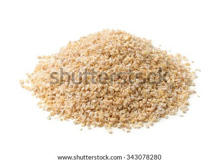 Heap of barley grits isolated on white - stock photo