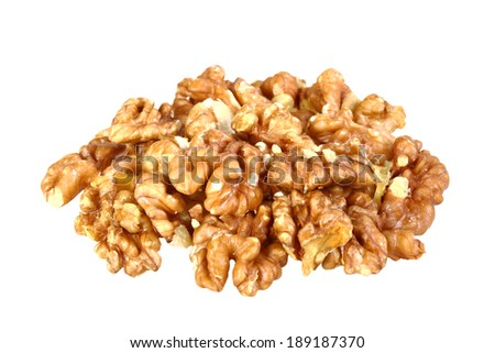 Heap of beige walnuts isolated on white background. Close-up. Studio photography.
