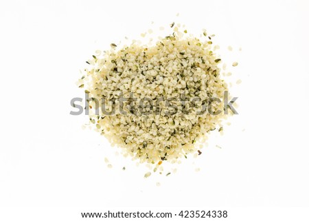 Heap of blanched hemp seeds , on white background - stock photo