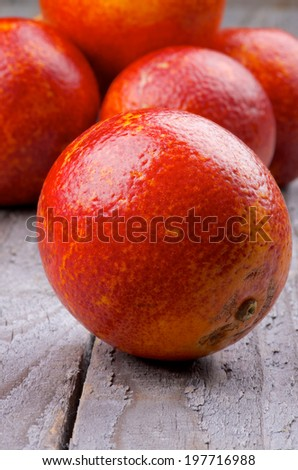 Heap of Blood Oranges Full Body closeup on Wooden background - stock photo