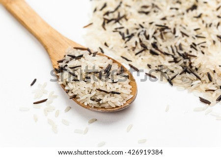 Heap of boiled mixed brown rice isolated on white - stock photo