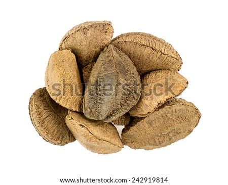Heap of brazil nuts isolated on white - stock photo