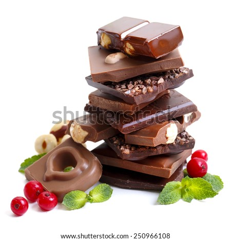 Heap of broken chocolate with cowberry on white background