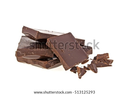 Heap of broken pieces of chocolate on white background