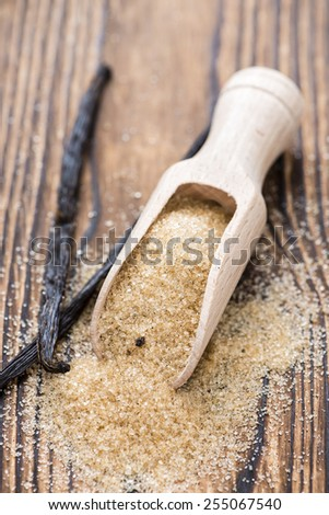 Heap of Brown Vanilla Sugar on wooden background - stock photo