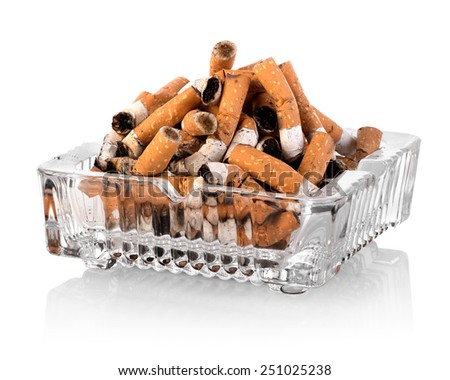 Heap of butts in a square ashtray - stock photo