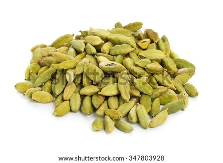 Heap of cardamom seed pods over white background - stock photo