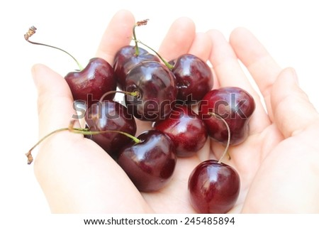 heap of cherry in lady hand