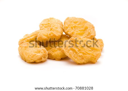 heap of chicken nuggets isolated on white background - stock photo