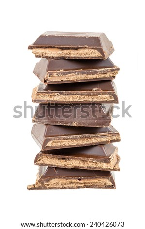 Heap of chocolate pieces isolated on white background with clipping path