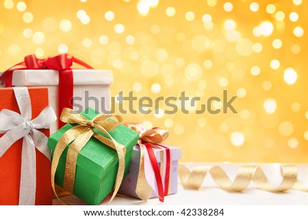 Heap of Christmas gift over blur light on background - stock photo
