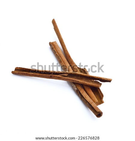 heap of cinnamon sticks isolated on white background, christmas spices - stock photo