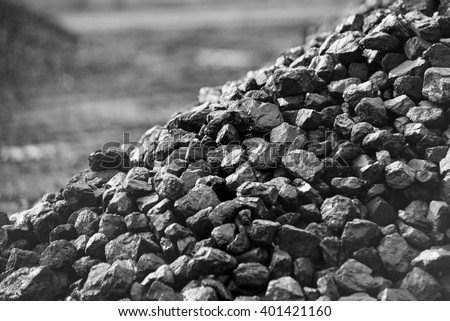 Heap of coal. A place, where coal is stored for selling. - stock photo