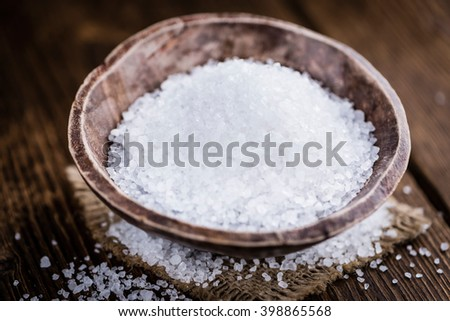 Heap of Coarse Salt (close-up shot) on vintage background (selective focus) - stock photo