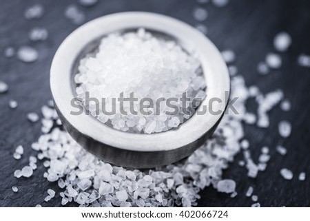 Heap of Coarse Salt (close-up shot) on vintage background (selective focus) - stock photo