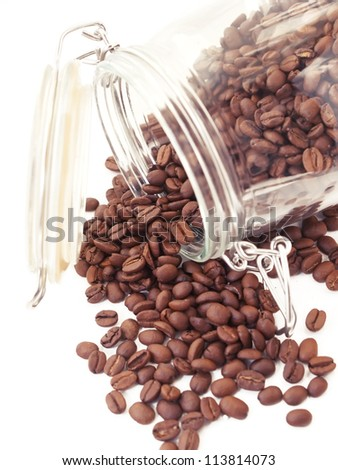 Heap of coffee beans from jar