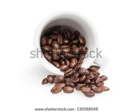 heap of coffee beans with cup, isolated on white