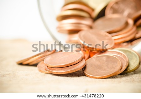 Heap of coins on wooden background,money concept