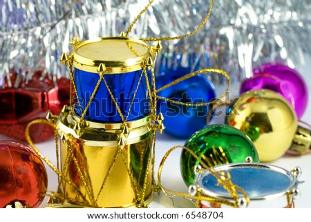 Heap of colorful christmas tree decorations of different types - stock photo