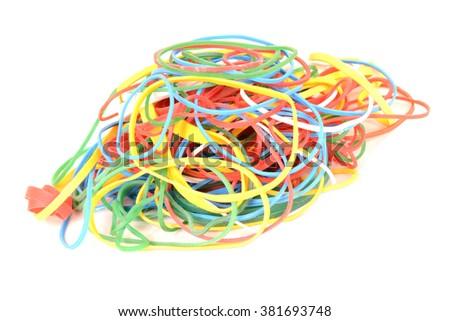 Heap of colorful elastics. Image isolated on white studio background. - stock photo