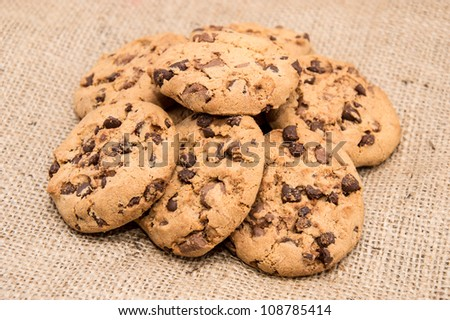 Heap of Cookies on textile background - stock photo